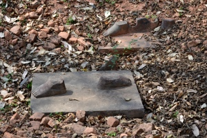 The feet of two ancient sandstone statues were left behind by looters at a temple in Koh Ker, Cambodia. One statue is now at Sotheby's, the other at the Norton Simon Museum in Pasadena.