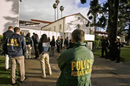 Federal agents descend upon the Bowers Museum in Santa Ana during a raid in January 2008
